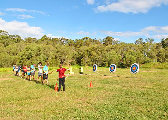 Scouts partaking in archery outdoor activity
